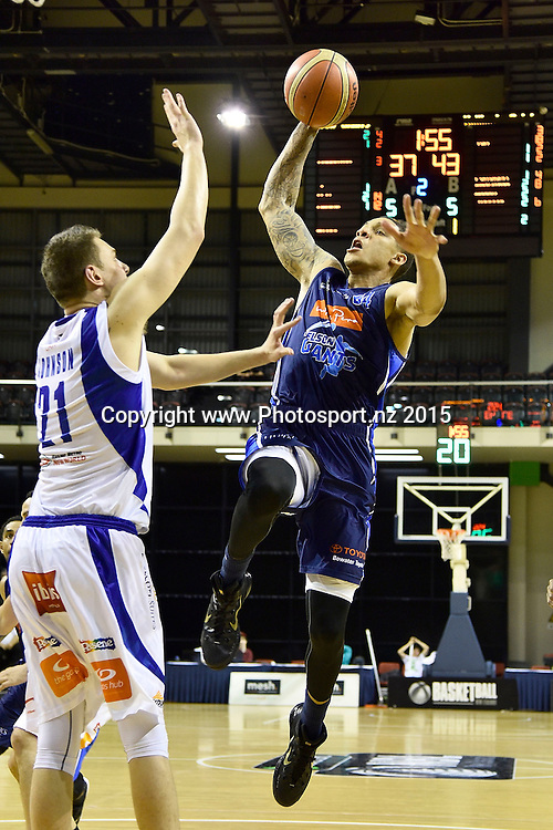 McKenzie Moore (R of the Giants slam dunks the ball with Daniel Johnson of the Saints during the NBL semi final basketball match between Wellington Saints and Nelson at the TSB Arena in Wellington on Saturday the 4th of July 2015. Copyright photo by Marty Melville / www.Photosport.nz