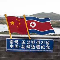 HUNCHUN, 09/12/2017:<br />  The Chinese and Korean national flags are displayed at a viewpoint at the border in Fangchuan.