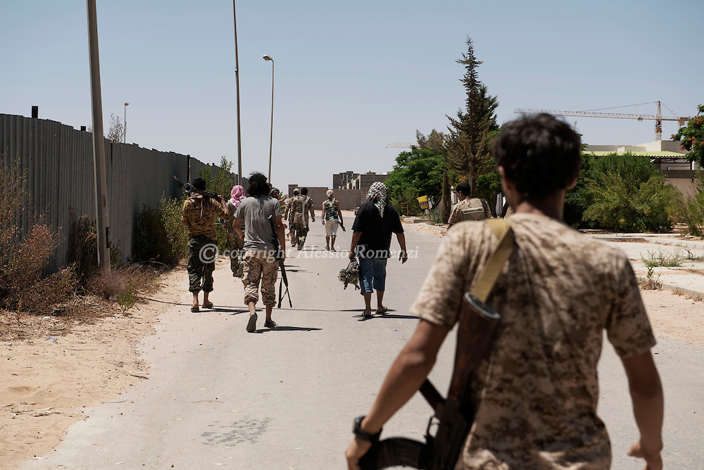 Libya: Libya's Government of National Accord's (GNA) fighters take position to dislodge ISIS snipers in 700 neighbourhood in Sirte. Alessio Romenzi