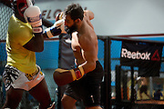 Johny Hendricks trains at Velociti Fitness Center in Pantego, Texas on November 6, 2013. (Cooper Neill / for Reebok)