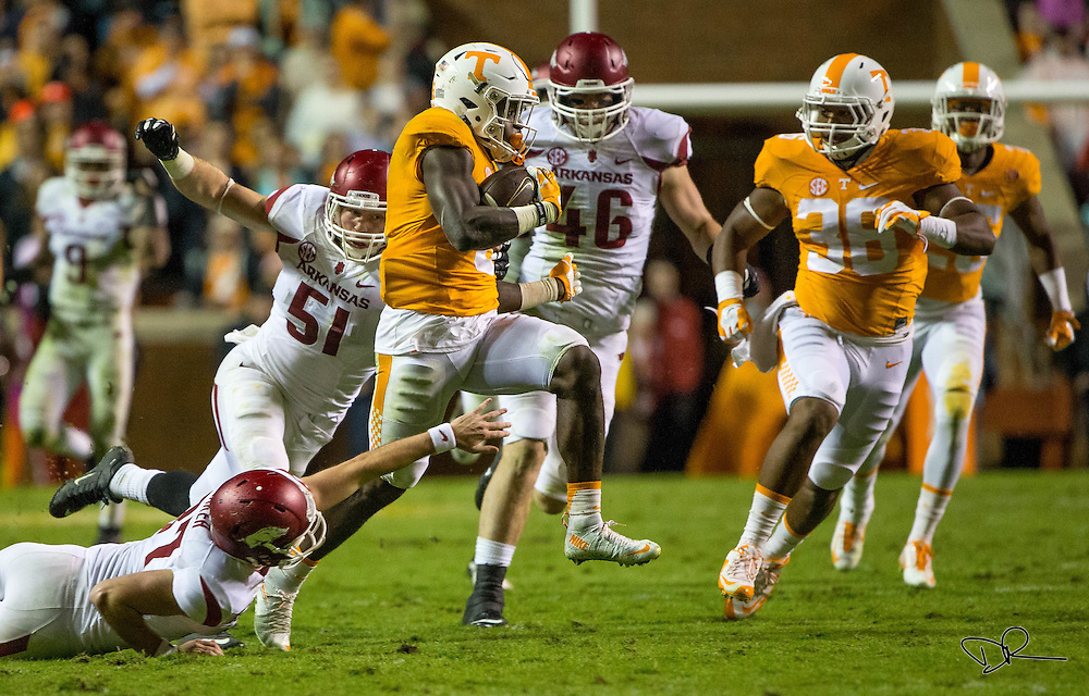 Tennessee Volunteer running back Alvin Kamara dodges tackles during an SEC footbal game against  the Arkansas Razobacks at Neyland Stadium on October 13, 2015. Arkansas would go on to win the game 24-20.