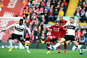 Liverpool midfielder Xherdan Shaqiri (23) and Fulham defender Calum Chambers (5) and Fulham midfielder Andre-Frank Zambo Anguissa (29) during the Premier League match between Liverpool and Fulham at Anfield, Liverpool, England on 11 November 2018.