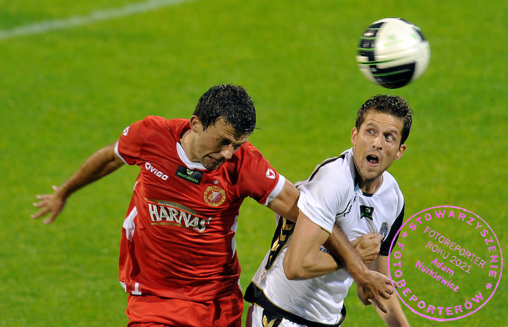 (L) VELIBOR DURIC (WIDZEW) & (R) ANDREU GUERAO MAYORAL (POLONIA) FIGHT FOR THE BALL DURING 4. ROUND SEASON 2010/2011 EXTRALEAGUE SOCCER MATCH BETWEEN WIDZEW LODZ AND POLONIA WARSZAWA AT WIDZEW'S STADIUM IN LODZ...LODZ , POLAND , AUGUST 28, 2010..( PHOTO BY ADAM NURKIEWICZ / MEDIASPORT )