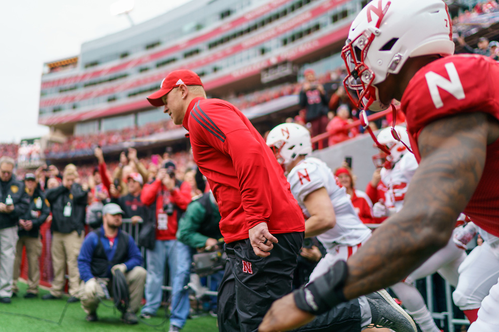 Scott Frost leads the team on the field prior to Nebraska's annual Spring Game at Memorial Stadium in Lincoln, Neb., on April 21, 2018. © Aaron Babcock