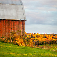 Red barn at sunset in autumn