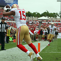 San Francisco 49ers wide receiver Michael Crabtree (15) catches a touchdown during an NFL football game between the San Francisco 49ers  and the Tampa Bay Buccaneers on Sunday, December 15, 2013 at Raymond James Stadium in Tampa, Florida.. (Photo/Alex Menendez)