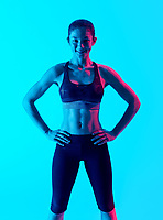 one mixed races woman exercsing fitness exercices isolated on blue blackground