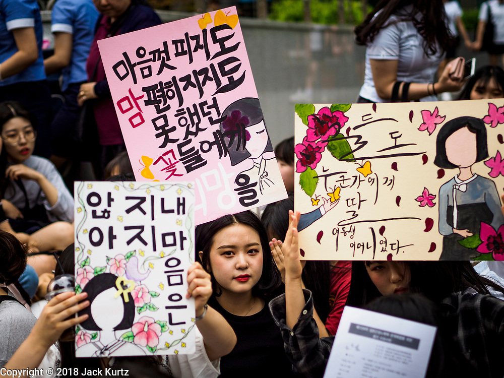 "SEOUL, SOUTH KOREA: South Korean women hold up placards during the Wednesday protest at the Japanese embassy in Seoul. The Wednesday protests have been taking place since January 1992. Protesters want the Japanese government to apologize for the forced sexual enslavement of up to 400,000 Asian women during World War II. The women, euphemistically called ""Comfort Women"" were drawn from territories Japan conquered during the war and many came from Korea, which was a Japanese colony in the years before and during the war. The ""comfort women"" issue is still a source of anger of many people in northeast Asian areas like South Korea, Manchuria and some parts of China.       PHOTO BY JACK KURTZ   <br /> Wednesday Demonstration demanding Japan to redress the Comfort Women problems"