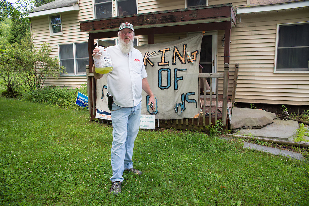 Ray Kem, a former industry worker in Dimock, PA holds up water taken from his contaminated well. His water well was contaminated shortly after Cabot Oil an Gas started drilling near his home.