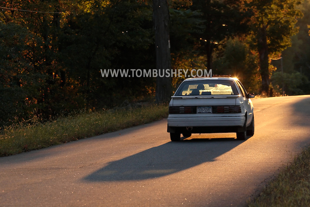 Salisbury Mills, N.Y. - A car drvies down tree-lined Otterkill Road in the late afternoon sunlight on Oct. 13, 2007.