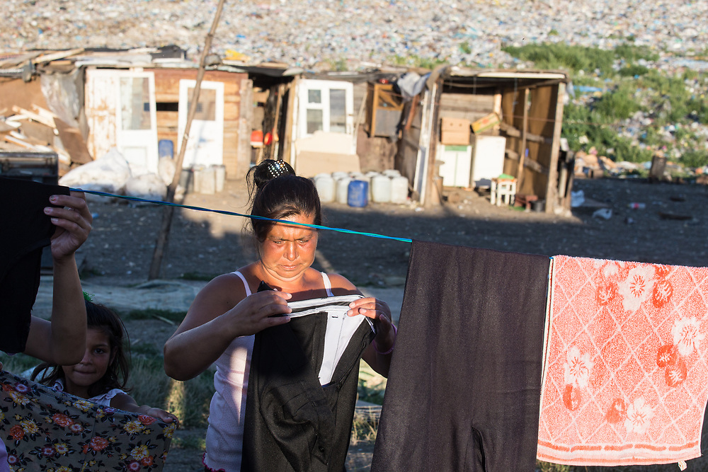 People belonging to the roma community go on their daily lives outside their makeshift houses built in the middle of the Pata Rat garbage dump.                                                         © Daniel Barreto Mezzano