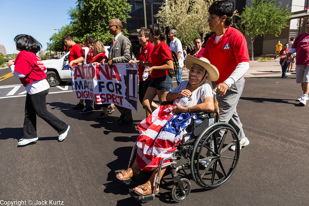 05 OCTOBER 2013 - PHOENIX, ARIZONA:     An elderly woman is pushed in her wheelchair during an immigration march in Phoenix. More than 1,000 people marched through downtown Phoenix Saturday to demonstrate for the DREAM Act and immigration reform. It was a part of the National Day of Dignity and Respect organized by the Action Network.    PHOTO BY JACK KURTZ
