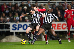 NEWCASTLE, ENGLAND - Saturday, December 11, 2010: Liverpool's Fernando Torres and Newcastle United's Sanchez Jose Enrique and Sol Campbell during the Premiership match at St James' Park. (Photo by: David Rawcliffe/Propaganda)