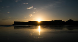 © Licensed to London News Pictures. <br /> 09/10/2014. <br /> <br /> Saltburn, United Kingdom<br /> <br /> Sunrise over Huntcliff in Saltburn by the Sea in Cleveland.<br /> <br /> Photo credit : Ian Forsyth/LNP