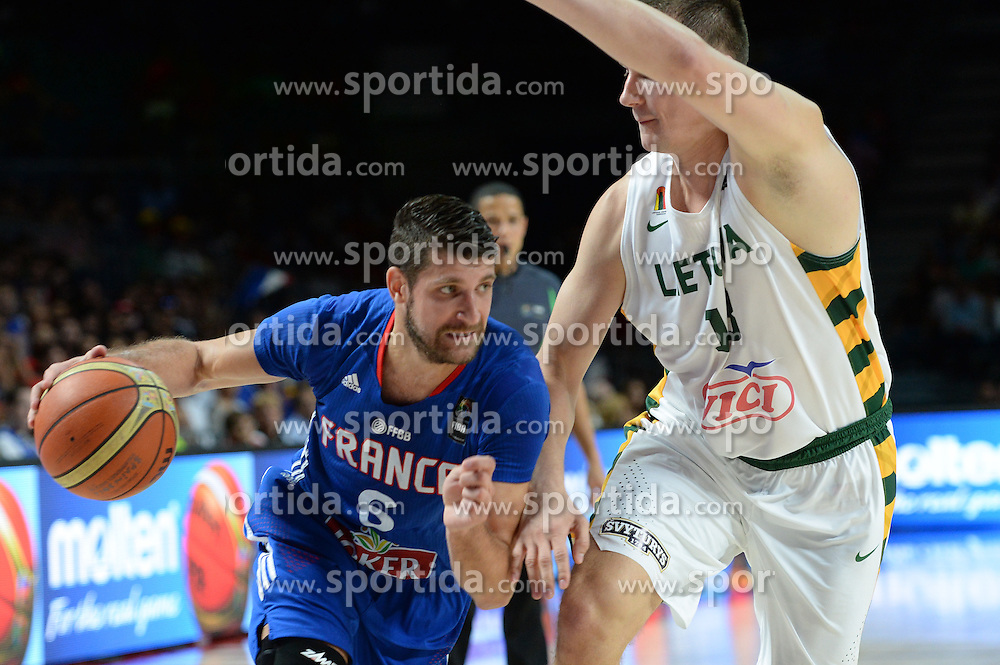 Antoine Diot of France vs Paulius Jankunas of Lithuania in action during the 2014 FIBA World Basketball Championship Third Place match between France and Lithuania at the Palacio de los Deportes, on September 13, 2014 in Madrid, Spain. Photo by Tom Luksys  / Sportida.com <br /> ONLY FOR Slovenia, France