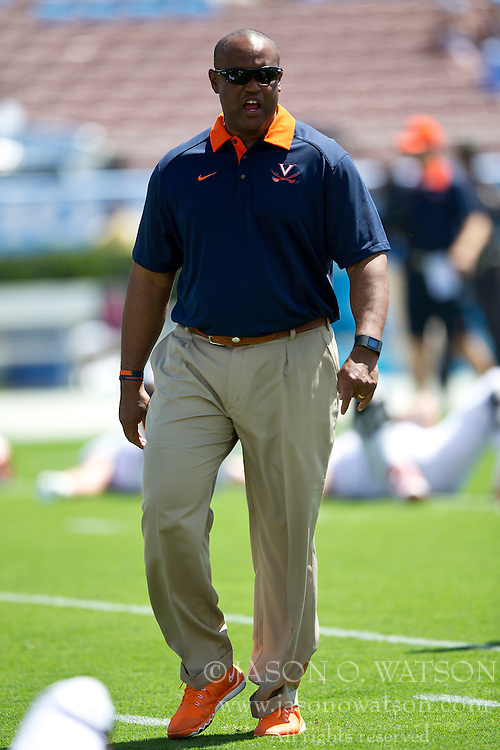 PASADENA, CA - SEPTEMBER 05:  Head coach Mike London of the Virginia Cavaliers stands on the field before the game against the UCLA Bruins at the Rose Bowl on September 5, 2015 in Pasadena, California.  The UCLA Bruins defeated the Virginia Cavaliers 34-16. (Photo by Jason O. Watson/Getty Images) *** Local Caption *** Mike London