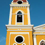 There has been a church on this spot since about 1525, but it was destroyed and rebuilt several times in the following centuries as the city of Granada was attacked by pirates and others. Construction on the current version began in 1888 but was not fully completed until 1972. With its distinctive yellow with white trim exterior, it stands over Parque Central in the heart of Granada, Nicaragua.