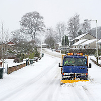 Heavy Snow in Perthshire...22.01.13<br /> A snow plough at work on the residential streets of Blairgowrie as snow continues to fall.<br /> Picture by Graeme Hart.<br /> Copyright Perthshire Picture Agency<br /> Tel: 01738 623350  Mobile: 07990 594431