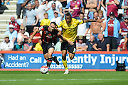 AFC Bournemouth's Marc Pugh and Aston Villa's Jordan Ayew during the Barclays Premier League match between Bournemouth and Aston Villa at the Goldsands Stadium, Bournemouth, England on 8 August 2015. Photo by Mark Davies.