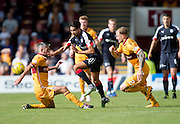 Dundee's Faissal El Bakhtaoui skips past Motherwell's Richard Tait and Keith Lasley - Motherwell v Dundee in the Ladbrokes Scottish Premiership at Fir Park, Motherwell. Photo: David Young<br /> <br />  - © David Young - www.davidyoungphoto.co.uk - email: davidyoungphoto@gmail.com