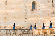 Catholic school girls walk to school past Santo Domingo church October 27, 2013 in Oaxaca, Mexico.