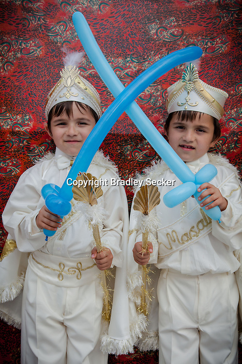 Arda and Yizit after their traditional circumcision in Sariyer, a town on the Bosphorus coastline north of Istanbul. The boys dress in costumes of Ottoman sultans on the day when they are seen as stepping into manhood.