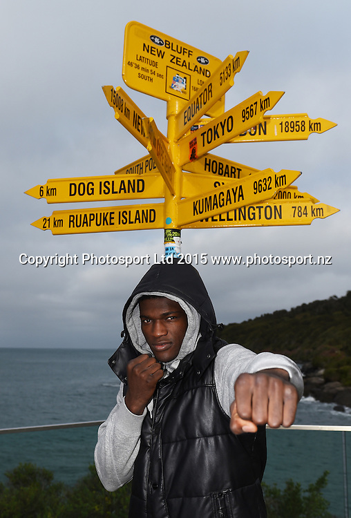 Heavyweight boxer Izu Ugonoh during a visit to the signpost at Stirling Point in Bluff ahead of the Burger King Road to the Title fight in Invercargill, New Zealand. Thursday 30 July 2015. Copyright photo: Andrew Cornaga / www.photosport.nz
