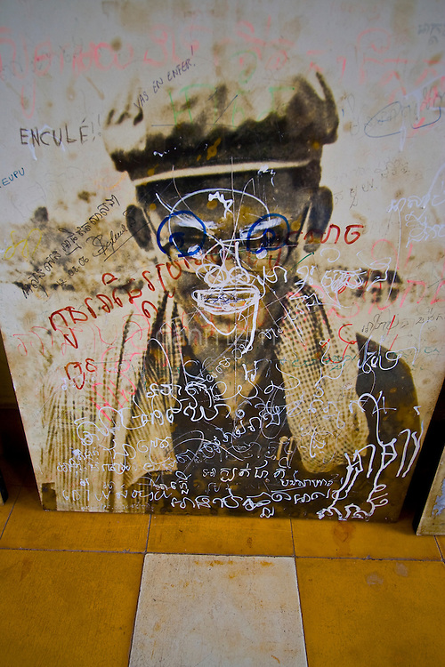 Photo of Khmer Rouge leader bears opinions of countless visitors to Tuol Sleng S21 Genocide museum, Phnom Penh, Cambodia