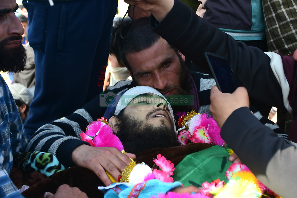 March 28, 2019 - Srinagar, India - Brother of slain militants Basharat Ahmad Dar hugs him during his funeral in Pulwama area of Indian Administered Kashmir on 28 March 2019. Three Kashmiri militantss were killed in an encounter with Indian Government Forces in Shopian district south of Srinagar. The slain Rebels were identified as Sajad Khanday, Aqib Ahmad Dar and Basharat Ahmad Mir residents of Pulwama district. Hundreds of people attended the funeral of the slain militantss and clashed with Indian Forces in many places. (Credit Image: © Muzamil Mattoo/NurPhoto via ZUMA Press)