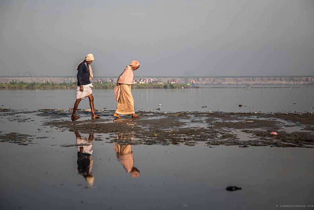 People walking along the Yamuna river. Vrindavan, India