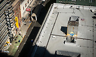 High-contrast light and shadow overview of a San Francisco street and rooftops