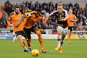 Wolverhampton Wanderers defender Dominic Iorfa and Burnley midfielder Scott Arfield chase the ball during the Sky Bet Championship match between Wolverhampton Wanderers and Burnley at Molineux, Wolverhampton, England on 7 November 2015. Photo by Alan Franklin.