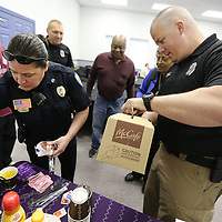 Adam Robison   BUY AT PHOTOS.DJOURNAL.COM<br /> Chamila Brown and Jon Bramble, both Sergeants with the Tupelo Police Department, serve coffee and biscuits to residents that attended coffee with a cop Friday morning at Life Changing Ministries in Tupelo.