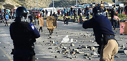 SOUTH AFRICA - Cape Town - 15 July  2020  - Youngstars pelt Law Enforcement and Metro Police officers with stones in Mfuleni ,when they evicted residents of Covid Informal Settlement.These residents invaded a vacant land that belongs to Cape Nature Reserve . Picture: Phando Jikelo/African News Agency(ANA)