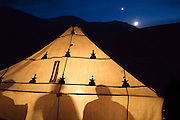 Trekking the High Atlas traverse.  The Atlas Mountains, Morocco. Venus rising and dining tent.