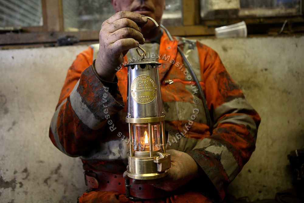 Heddwyn Williams, 52, one of the miners working to restore Unity Mine is holding a typical underground lamp used instead of the historic canarin as a way of checking for gas leakage, on Friday, Apr. 13, 2007, in Cwmgwrach, Vale of Neath, South Wales. The time is ripe again for an unexpected revival of the coal industry in the Vale of Neath due to the increasing prize and diminishing reserves of oil and gas, the uncertainties of renewable energy sources, and the technological advancement in producing energy from coal while limiting emissions of pollutants, has created the basis for valuable investment opportunities and a possible alternative to the latest energy crisis. Unity Mine, in particular, has started a pioneering effort to revive the coal industry in the area, reopening after more than 8 years with the intent of exploiting the large resources still buried underground. Coal could be then answer to both, access to cheaper and paradoxically greener energy and a better and safer choice than nuclear energy as a major supply for the decades to come. It is estimated that coal reserves in Wales amount to over 250 million tonnes, or the equivalent of at least 50 years of energy supply, while the worldwide total coal could last for over 200 years as a viable resource compared to only a few decades of oil and natural gas.