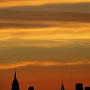 2016 U.S. Open - Day 14  The Manhattan New York City skyline at sunset showing the Empire State Building and the Chrysler building shot from the Arthur Ashe Tennis Stadium at the USTA Billie Jean King National Tennis Center on September 5, 2016 in Flushing, Queens, New York City.  (Photo by Tim Clayton/Corbis via Getty Images)