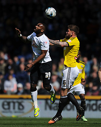 Derby Darren Bent battles with Brentford Dean Harlee, Derby County v Brentford, Sy Bet Championship, IPro Stadium, Saturday 11th April 2015. Score 1-1,  (Bent 92) (Pritchard 28)<br /> Att 30,050