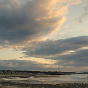 I was fortunate to have a cloudy morning sunrise on Cape Ann, MA.  This gave me the opportunity to capture these wonderful sky views.  I have taken some small liberties in post processing to get the most out of this image.