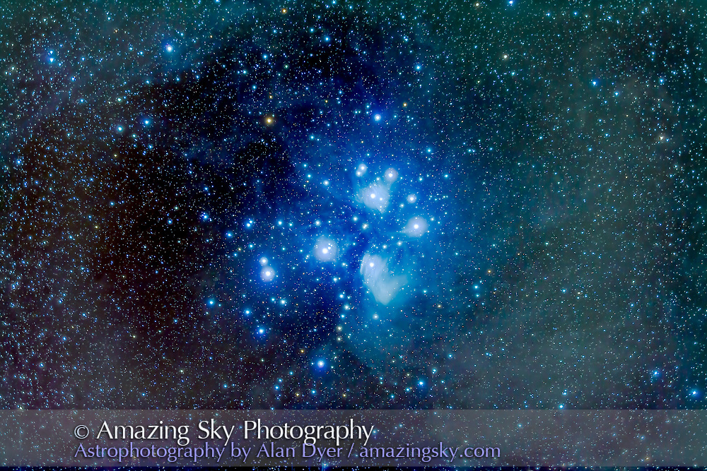 The Pleiades star cluster, or Seven Sisters, aka Messier 45, in Taurus. The brightest part of the reflection nebula around the Pleiades at bottom is the Merope Nebula, IC 349. In this image, I&rsquo;ve shot long exposures at low ISO speeds to record faint structure at low noise, to allow me to bring out the faint dusty nebulosity all around the region in processing.<br /> <br /> This is a stack of 10 x 12 minute exposures with the filter-modified Canon 5D MkII at ISO 400 through the TMB 92mm apo refractor at f/4.4 with the Borg. 0.85x field flattener/reducer. Taken from New Mexico, Nov 17, 2014.