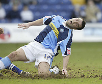 Photo: Aidan Ellis.<br /> Mansfield Town v Wycombe Wanderers. Coca Cola League 2. 24/02/2007.<br /> Wycombe's Scott McGleish feels the pain challenging for the ball