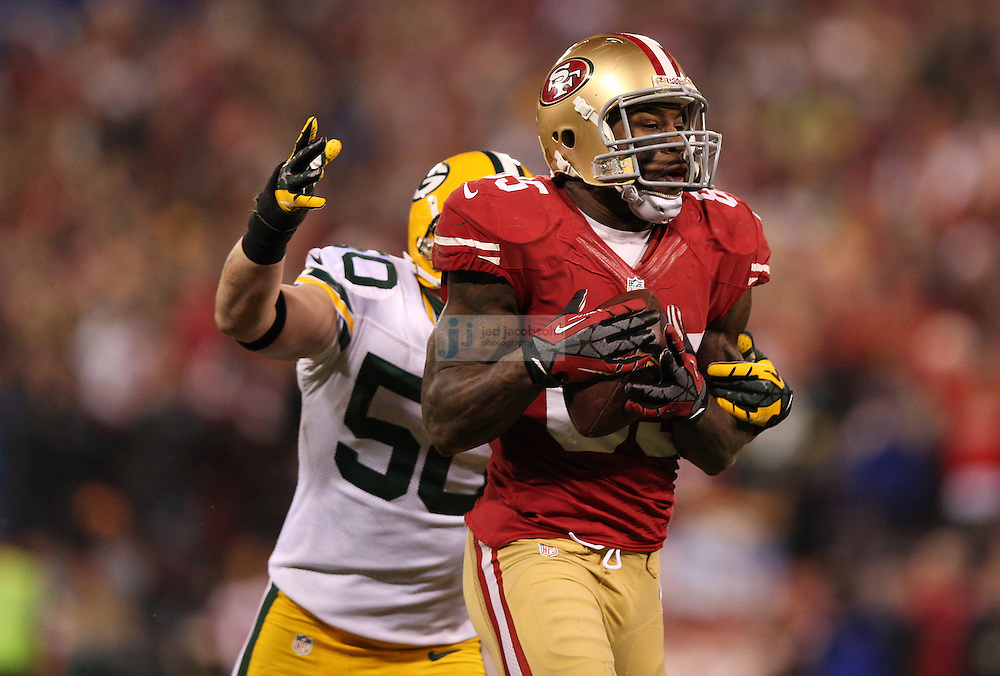 San Francisco 49ers tight end Vernon Davis (85) catches a pass over Green Bay Packers inside linebacker A.J. Hawk (50) during a NFL Divisional playoff game at Candlestick Park in San Francisco, Calif., on Jan. 12, 2013. The 49ers defeated the Packers 45-31. (AP Photo/Jed Jacobsohn)