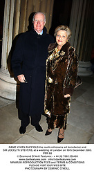 DAME VIVIEN DUFFIELD the multi millionaire art benefactor and SIR JOCELYN STEVENS, at a wedding in London on 16th December 2003.PPR 68