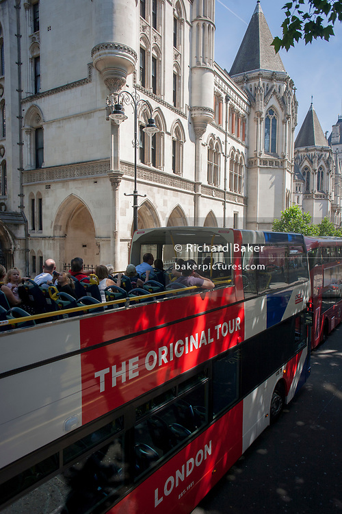 A tour bus with The Original Tour drives past the Royal Courts of Justice on Fleet Street, on 7th July 2017, in central London.