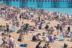 © Licensed to London News Pictures. 31/05/2020. Brighton, UK. Members of the public take the the beach in Brighton and Hove as hot and sunny weather is hitting the seaside resort. Photo credit: Hugo Michiels/LNP