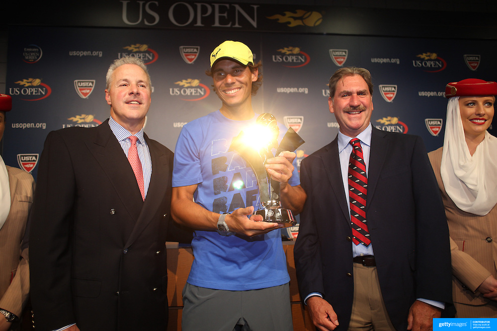 2013 Emirates Airline US Open Series Champion Rafael Nadal, USA, presented with his trophy from David Brewer, USTA Chief Professional Tennis Officer and US Open Tournament Director (left) and Dave Haggerty, USTA Chairman, CEO and President during a press conference at the US Open. Flushing. New York, USA. 24th August 2013. Photo Tim Clayton