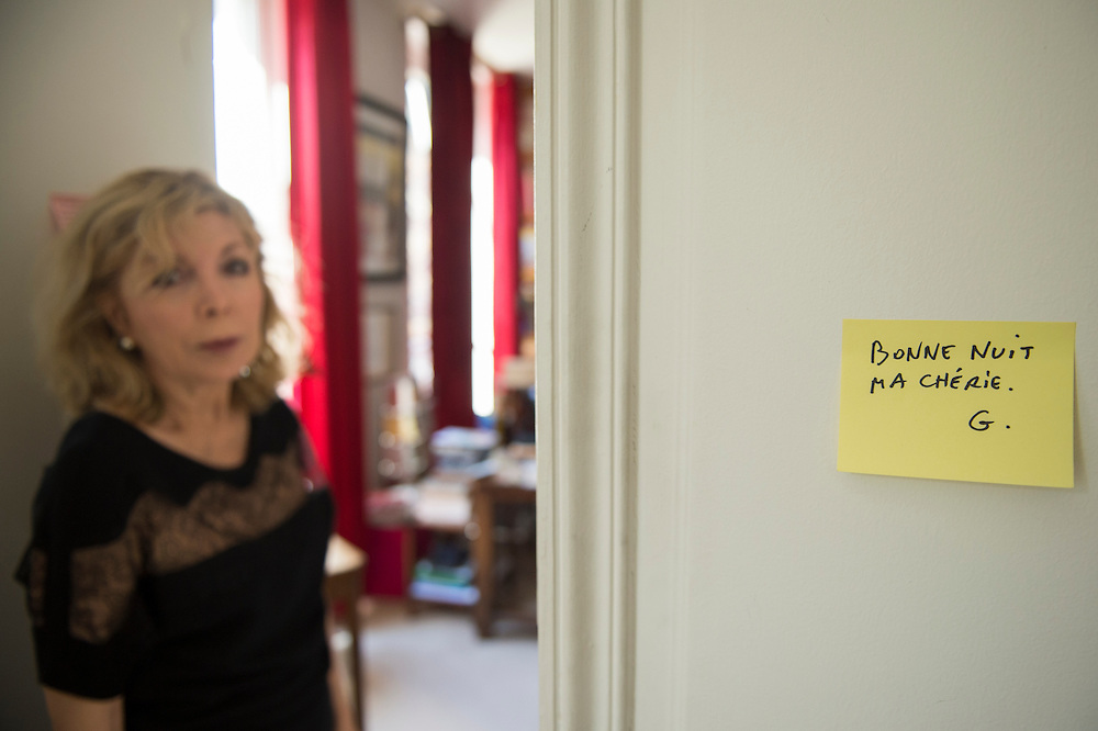 March 6, 2015, Paris, France. Maryse Wolinski (1943, Algiers) standing beside a post-it note of her assassinated husband Georges Wolinski. Post-it notes still decorate the Paris&rsquo; apartment where Georges and Maryse Wolinski used to live. French Cartoonist Georges Wolinski (1934 &ndash;2015) wrote daily post-it notes to his wife Maryse Wolinski. Two month after the death of Georges Wolinski, the apartment is full of souvenirs and notes, attesting a half-century-long love relation: &quot;Good night my darling. G.&quot; <br /> The cartoonist Georges Wolinski was 80 years old when he was murdered by the French jihadists Ch&eacute;rif en Sa&iuml;d Kouachi, he was one of the 12 victims of the massacre in the Charlie Hebdo offices on January 7, 2015 in Paris. Charlie Hebdo published caricatures of Mohammed, considered blasphemous by some Muslims. During his life, Georges Wolinski defended freedom, secularism and humour and was one of the major political cartoonists in France. The couple was married and had lived for 47 years together. Photo: Steven Wassenaar.