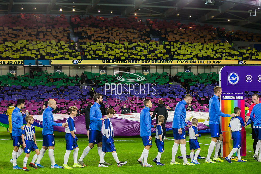 Brighton & Hove Albion FC supporters  showing their support for Rainbow Laces Campaign 'Make Sport Everyone's Game' ahead of the Premier League match between Brighton and Hove Albion and Wolverhampton Wanderers at the American Express Community Stadium, Brighton and Hove, England on 8 December 2019.