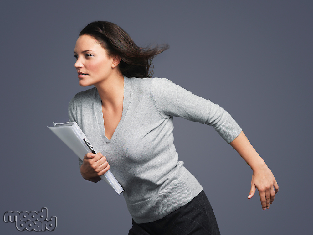 Determined Young Businesswoman leaning into wind