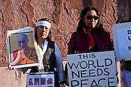 Roma 22 Ottobre 2011.Marcia Internazionale per la Libertà dei popoli Birmano, Iraniano, Tibetano, Uyghuro. Manifestante con il ritratto del Daila Lama.Rome October 22,2011.Marcia International Freedom of the people of Burma, Iran, Tibetan, Uyghur